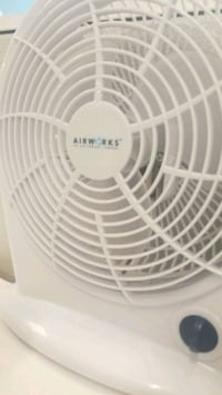white and gray desk fan