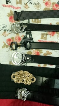 six assorted-brand black leather belts