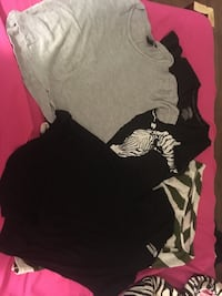four black and gray crew-neck shirts
