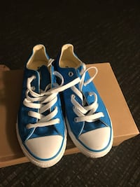 pair of blue-and-white Converse shoes
