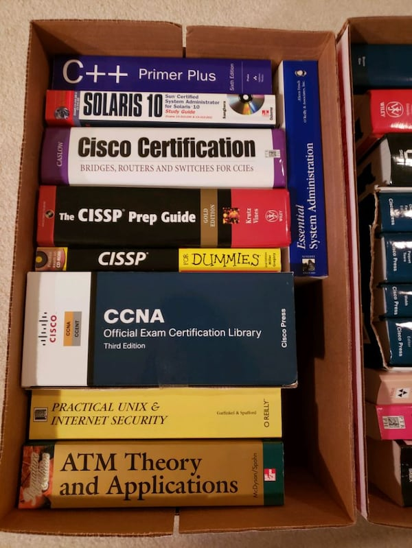 Boxes of  Cisco technical manuals & study guides  f5f98b7c-e80d-40be-8b76-411bcdc9145b