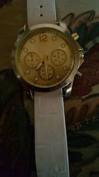 round silver chronograph watch with brown leather  Brampton, L6W 3G1