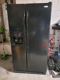 Side by side refrigerator. Clean in and out but trips circuit breaker