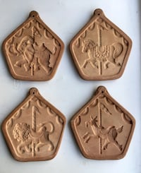 Four terra-cotta vintage cookie molds. Each in the shape of a beautiful intricate carousel figure. Never used. Circa 1980s New York, 11229
