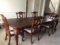 Dining table with leaf and six chairs.