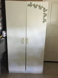 white wooden 2-door wardrobe
