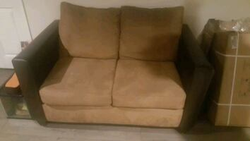 Leather and microfiber love seat