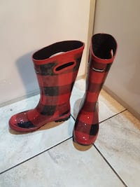 pair of red-and-black rain boots