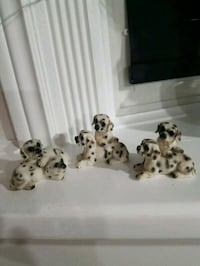 Beautiful  ceramic dogs figurines. perfect condition. $5 each