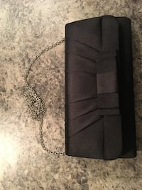 black le chateau clutch
