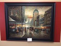 black framed painting of people near brown concrete buildings Naperville, 60564