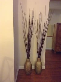 two brown vases with decorative twigs