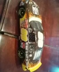 black and yellow die-cast toy car