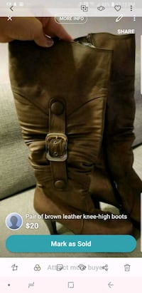 brown leather cowboy boots screenshot Calgary, T3M 0J1