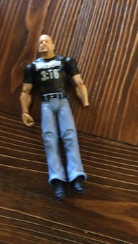man in black shirt and gray pants action figure