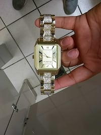 square gold analog watch with link bracelet