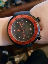 round black and red analog watch Windsor, N8X 2Z9