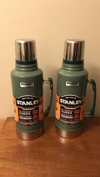 two green Stanley thermal carafe