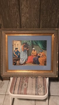 woman with brown dress painting with brown wooden frame