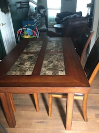 Dining table with 4 chairs and bench. Table legs need some work. Frederick, 21703