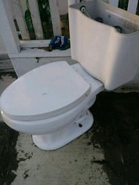 white ceramic toilet bowl with cistern