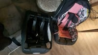 baby's black and pink car seat carrier Chestermere, T1X 1S5
