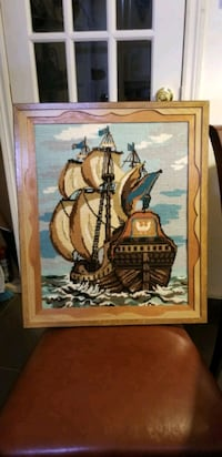 brown wooden framed painting of sailing ship