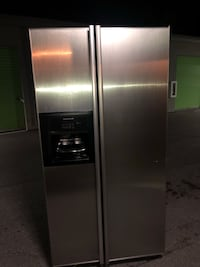 stainless steel side-by-side refrigerator with dispenser West Palm Beach, 33406