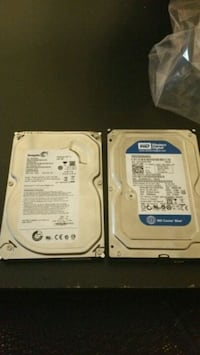 2 PC hard drives left one is 500g and the right one is 250g