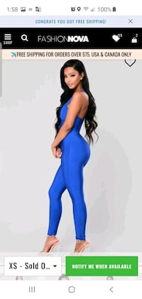 Blue form fitting jumpsuit