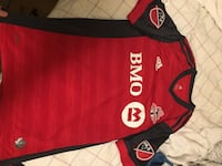 red and black Adidas jersey shirt