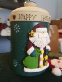 green with Santa Claus printed canister