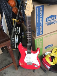 Red and white stratocaster electric guitar Albuquerque, 87109