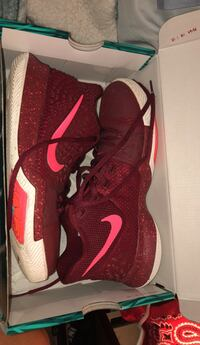Pair of red-and-white nike running shoes Avon Park, 33825