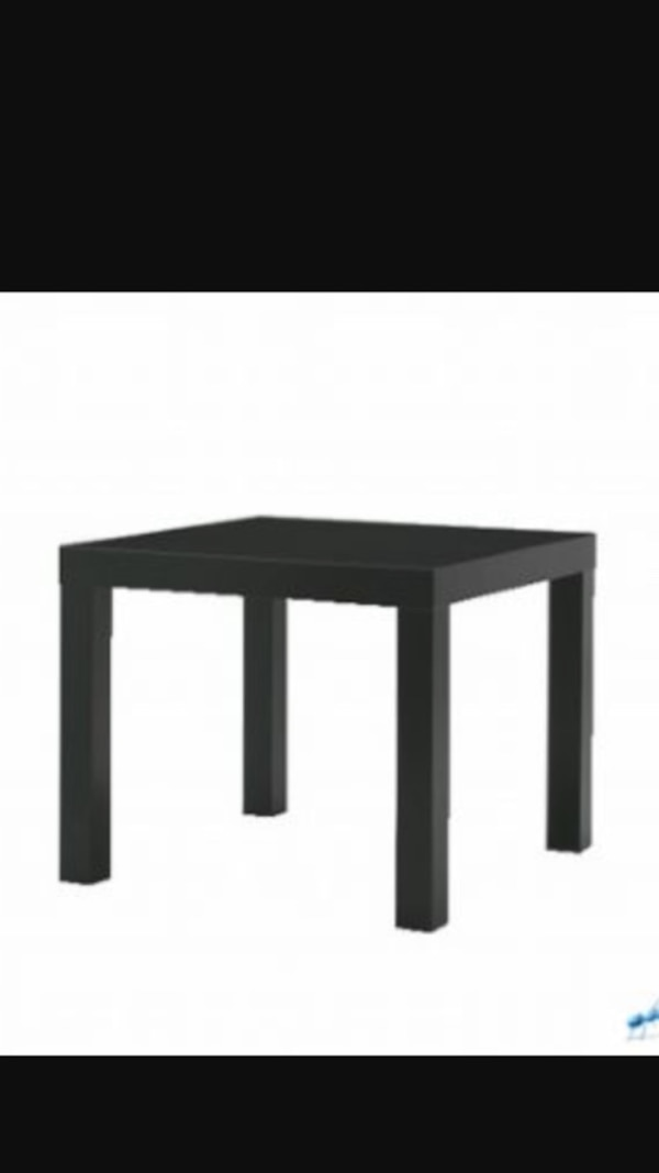 black wooden end table 9cdc0275-ac1a-4103-bcd8-32a01efefb01