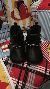 pair of toddler's black chained booties