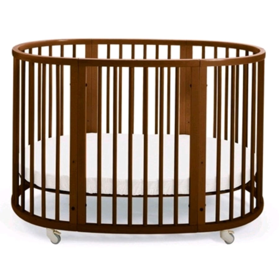 Stokke sleepie convertible crib in walnut .