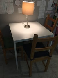 IKEA white dining table with 4 wood chairs  Surrey, V3S 0W3