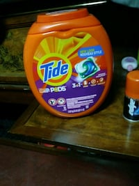 Tide detergent bottle with text overlay Los Angeles