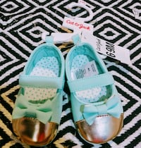 pair of teal-and-white sandals Knoxville, 37923
