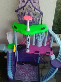 toddler's pink and green plastic dollhouse