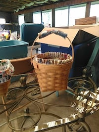 two brown wicker baskets with black metal stand Middletown, 21769