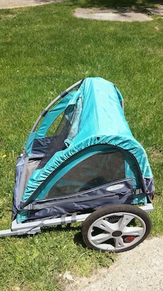 teal and black pet stroller like new