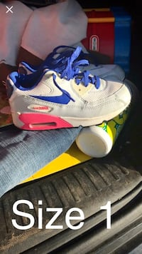 pair of white-and-blue Nike sneakers 216 mi
