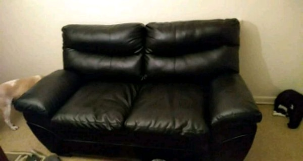 Brand new leather black love seat