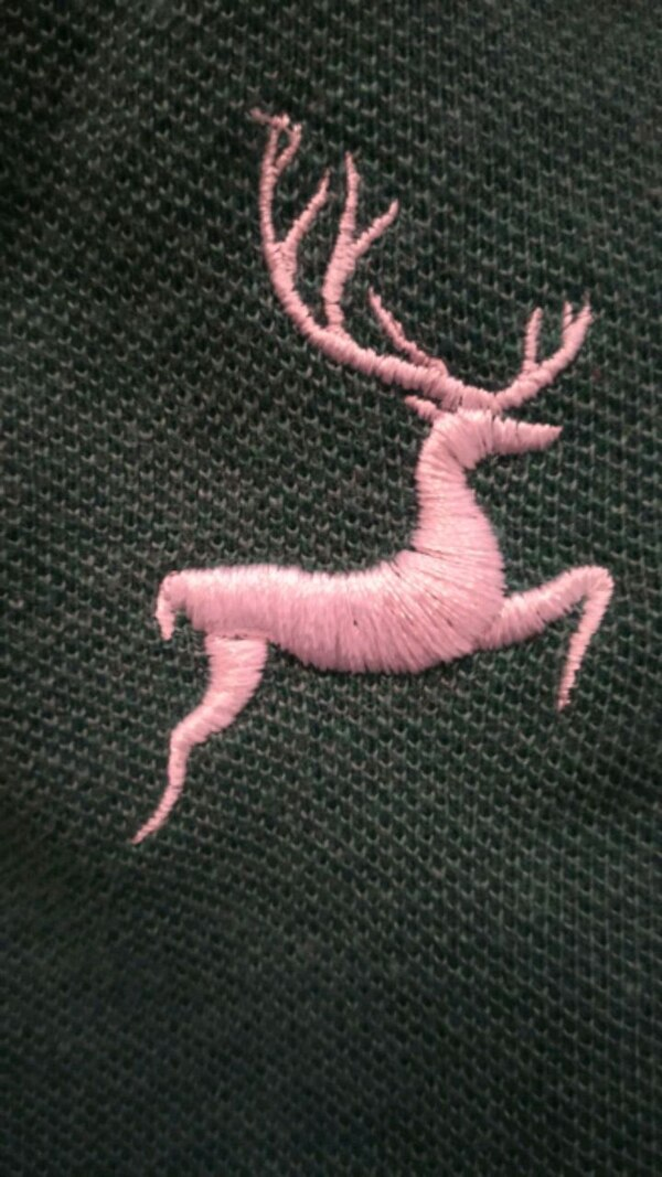 pink and black knitted textile