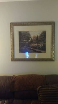 brown wooden framed painting of house London, N5V 1N2