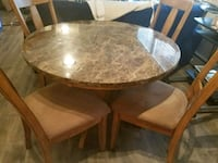 round brown wooden table with four chairs dining s Gaithersburg, 20877
