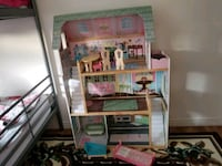 white and pink wooden dollhouse Calgary, T3J 2B9