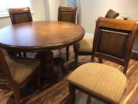round brown wooden table with four chairs dining set Georgetown, L7G 0B7